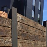 DRAMATIC WALL FROM OLD WEATHERED OAK RAILWAY SLEEPERS SLOTTED INTO STEEL RSJ'S