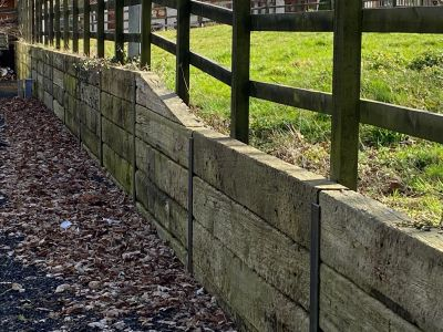 Retaining wall made from railway sleepers slotted into steel RSJs