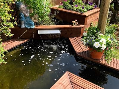 BEAUTIFUL RAISED DECKING POND WITH NEW RAILWAY SLEEPERS