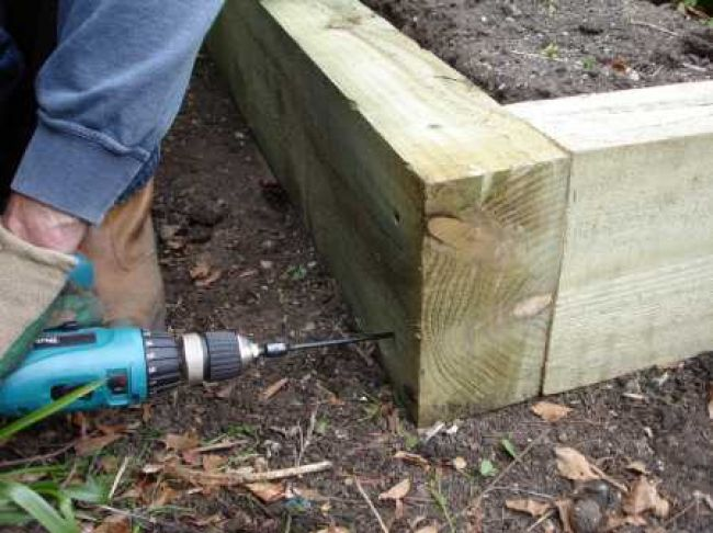 how to make a raised flower bed with railway sleepers 2