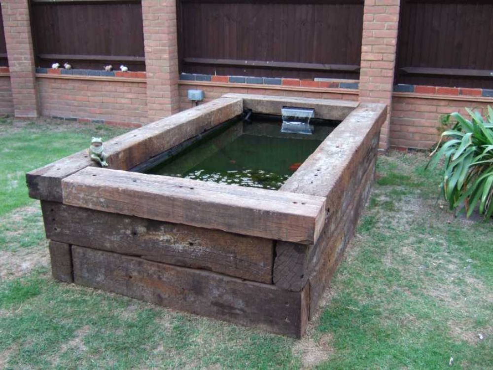 How to build a raised pond with railway sleepers for Wooden koi pond construction