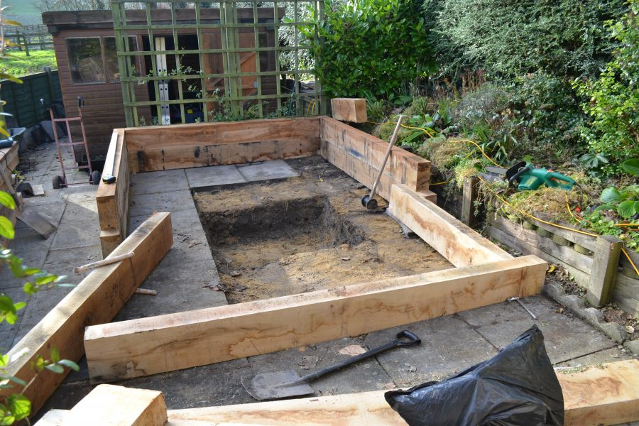 Koi carp pond with railway sleepers for Garden pond design using sleepers