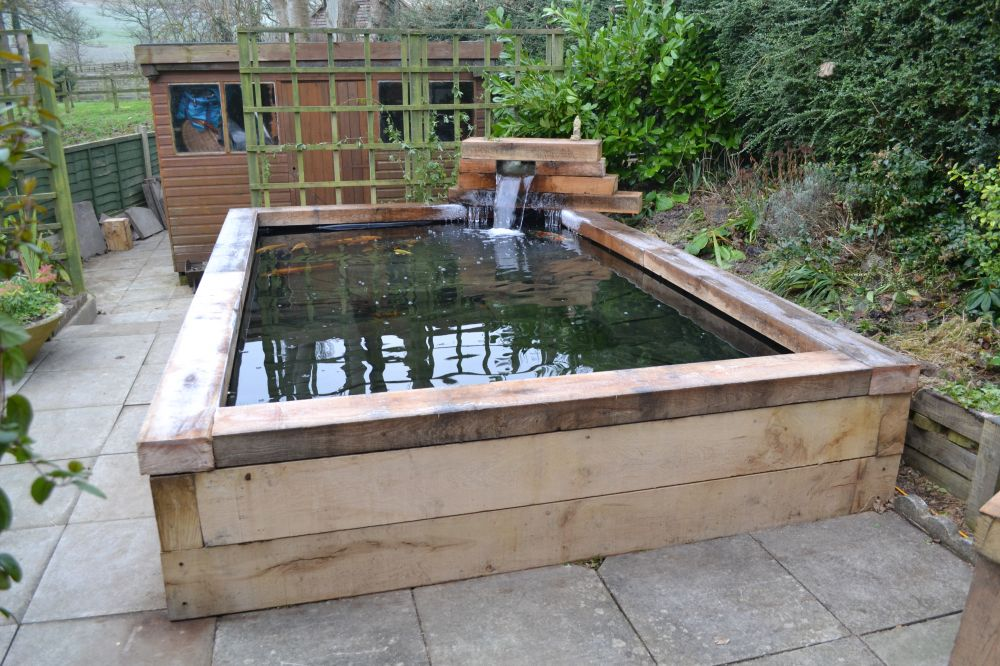 Koi carp pond with railway sleepers for Wooden koi pond construction