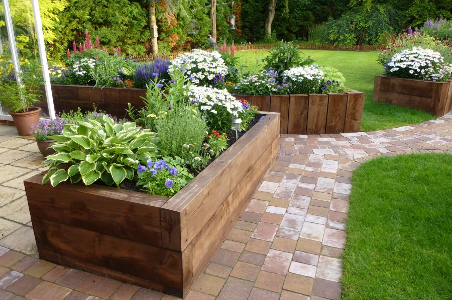Railroad tie raised garden bed