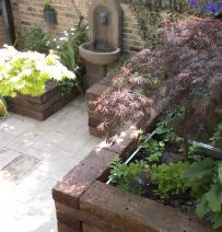Aila's Raised beds with railway sleepers