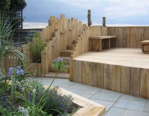 Raised bed projects with railway sleepers for Garden decking sleepers