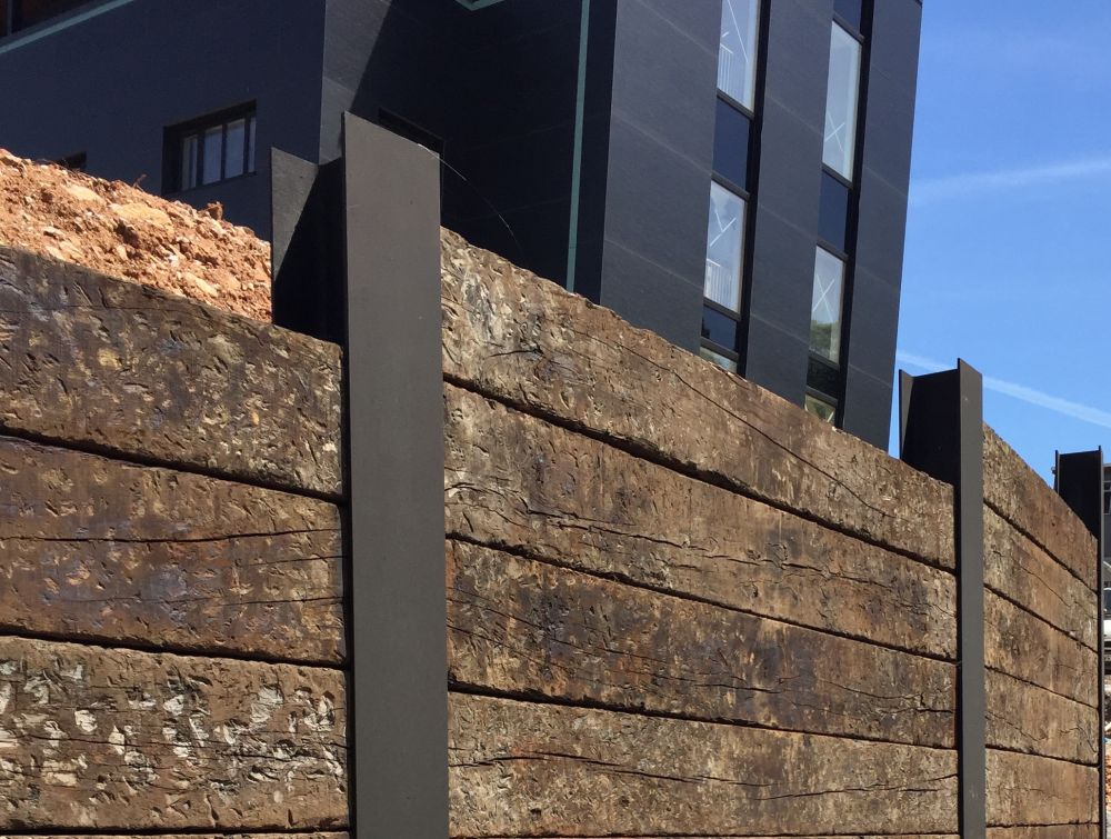 Metal Post Retaining Wall Plank : Wall of used oak railway sleepers slotted into rsjs