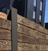 Botree Group's wall using oak Railway Sleeper slotted into RSJs