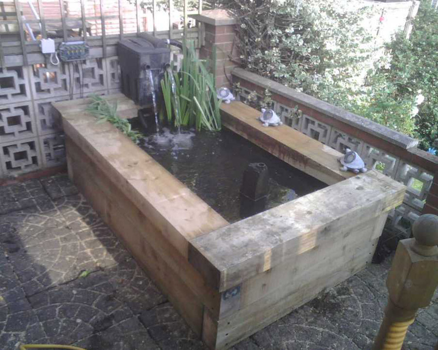 Railway sleepers for Raised koi pond construction