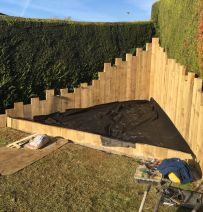 Eoin's bespoke patio with upright railway sleepers