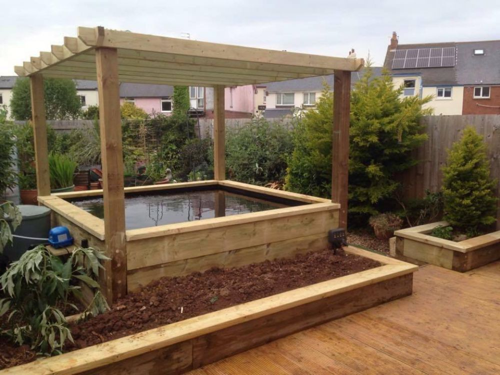 Railway sleeper pond pergola and raised beds for Raised garden pond designs