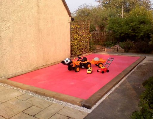 Graham's red play area with railway sleeper edging