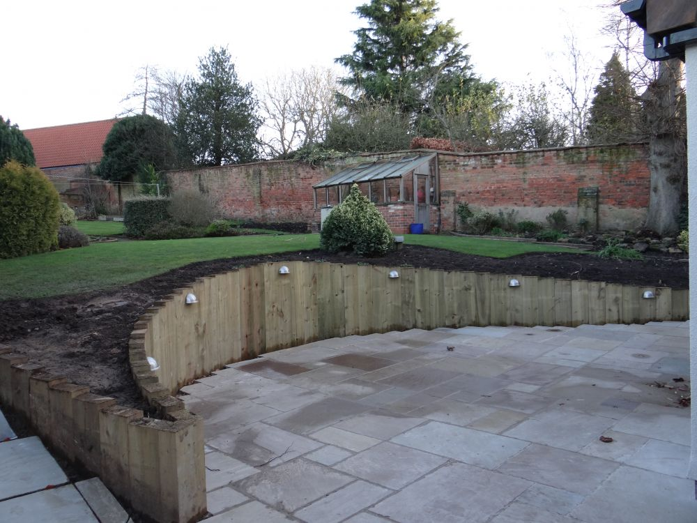 Wall from new railway sleepers for Curved garden wall designs