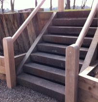 Bold steps from railway sleepers that cut through terrace
