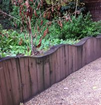 Chelsea Physic Garden's wavy wall with sleepers