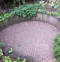 Chelsea Physic Garden's circular patio with sleepers