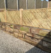 Attractive wall created from blocks of old Railway sleepers