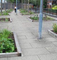 London Embankment raised beds with oak railway sleepers
