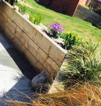 Kate Hindley's new railway sleeper raised terrace wall