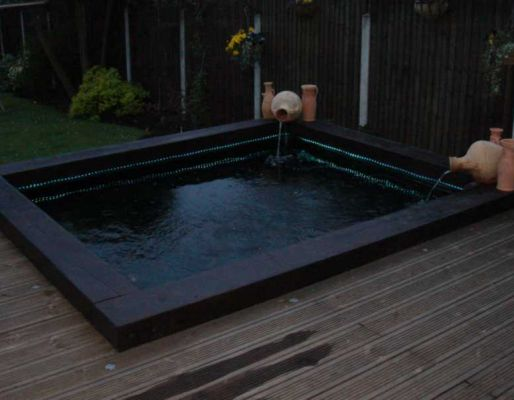 Pond water feature with railway sleepers for Wooden koi pond construction