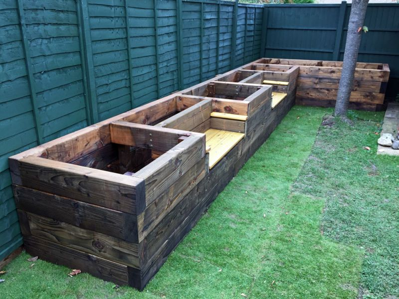 Les mable 39 s raised beds with bench seats from new railway for Garden pond design using sleepers