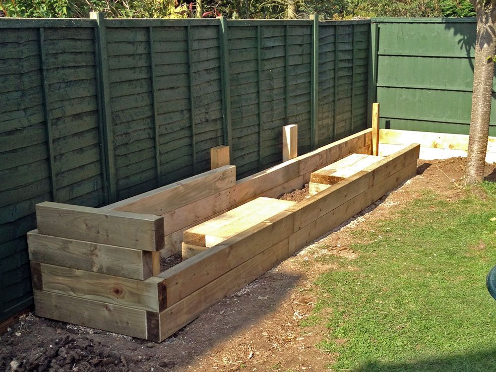 Les Mable's raised beds with bench seats from new railway ...