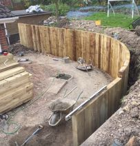 Mark's curved retaining wall with new railway sleepers