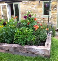 Melisa's raised flower bed with used oak railway sleepers