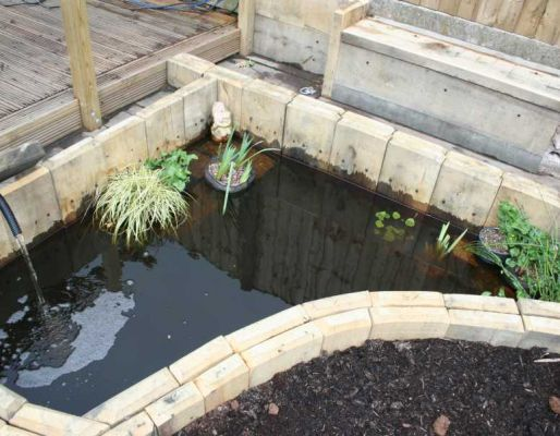 Mike Irving's pond lined with new oak railway sleepers