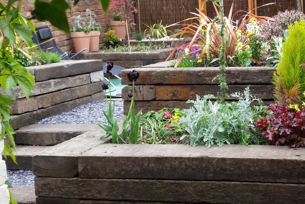 Mike's impressive Jarrah raised beds from used jarrah railway sleepers