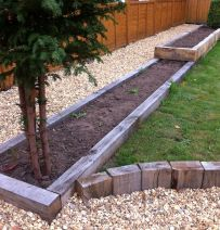 Low level raised beds from silver grey new oak railway sleepers