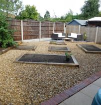 Phillip's new railway sleeper raised bed gravel garden