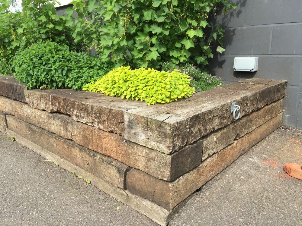Norfolk lavender railway sleeper raised beds for Garden designs using sleepers
