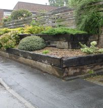 Open gardens uncover raised beds with railway sleepers