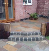 Paul & Ben's circular patio with used railway sleepers