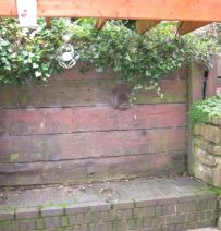 Pam's retaining wall seat with railway sleepers