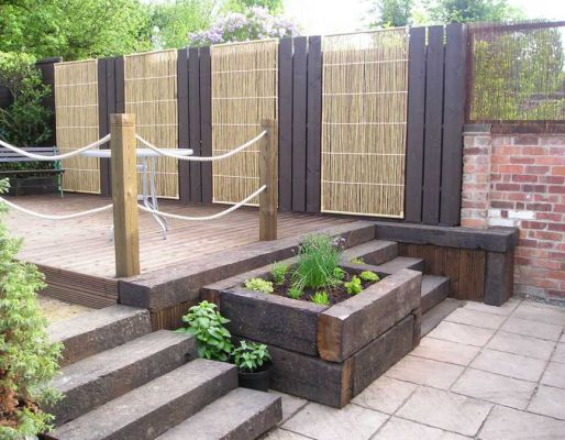 Decking projects with railway sleepers for Garden decking for sale