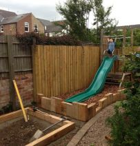 Blue leaf landscapes play area with railway sleepers