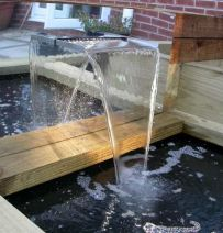Impressive raised bed water feature using railway sleepers