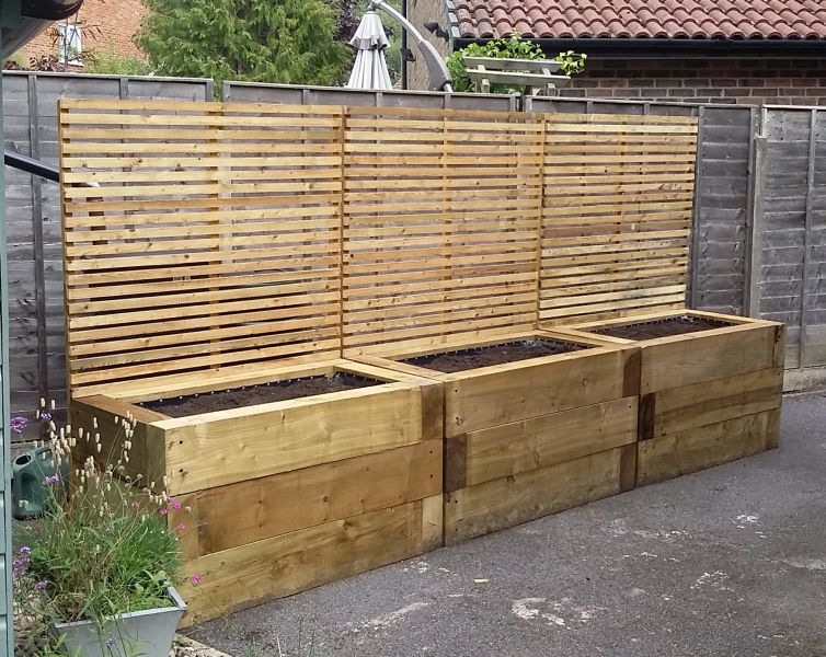 Railway sleeper raised bed decking for Decking at end of garden