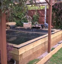Bob & Margaret's transform an old pond with new railway sleepers
