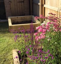 Chris's raised bed on a slope with new pine railway sleepers