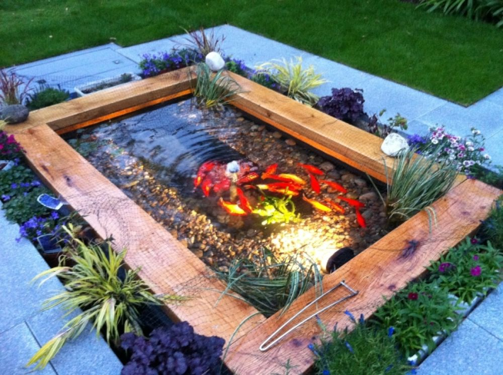Pond with new oak railway sleepers for Outdoor goldfish pond ideas