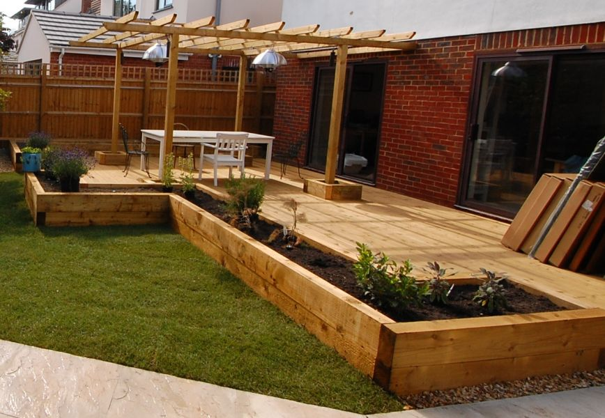 New oxford railway sleeper patio raised beds for Garden decking borders