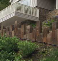 South Sands dramatic beach house railway sleeper wall