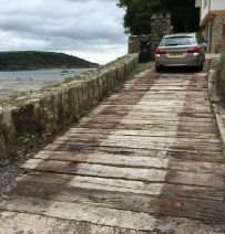 Salcombe beach house driveway made from old railway sleepers