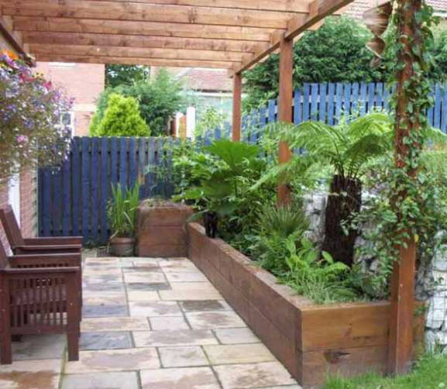 Railway sleepers for Small fenced in patio ideas