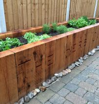 John & Sharon's beautifully carved railway sleeper raised herb bed