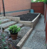 Simon's raised bed & stairs from new oak railway sleepers