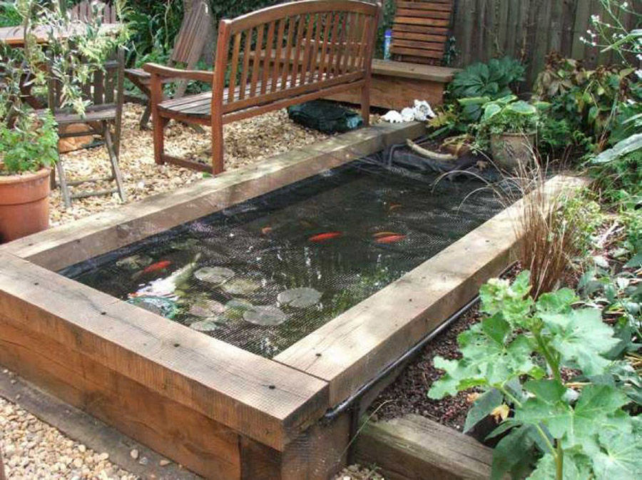 Railway sleepers Above ground koi pond design ideas